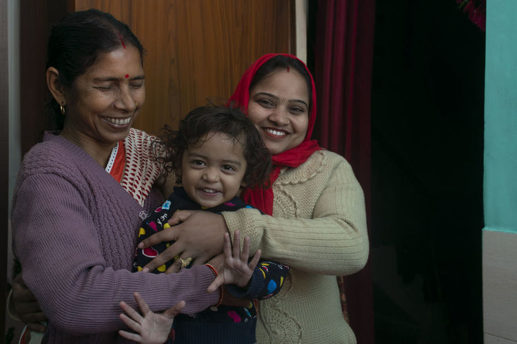 Happy grandmother, mother and child