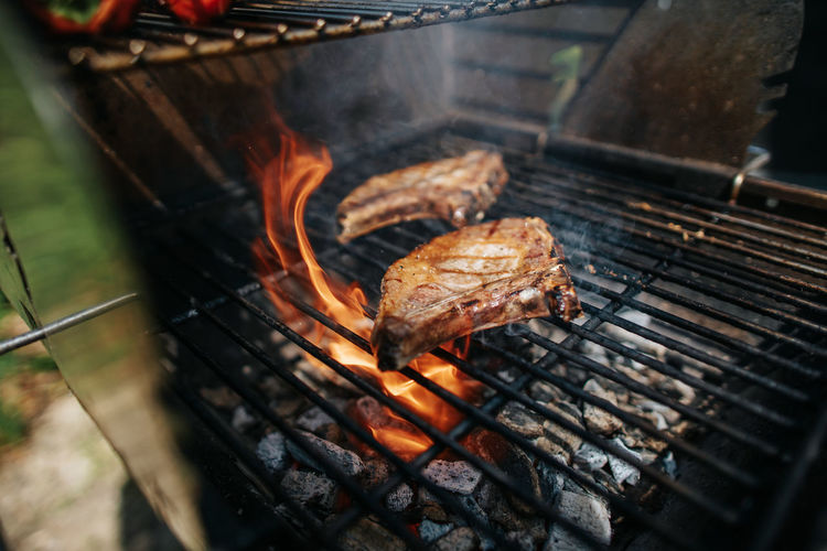 Two iberico chops with high flame on grill
