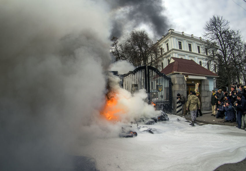 Flames are doused by firefighters after fighters of the Aydar Ukrainian volunteer battalion, burn tyres at the entrance to the Ukrainian Defence Ministry Ministry Of Defense Air Pollution Architecture Aydar Bonfire Building Exterior Built Structure Burn Burning Destruction Doused Entrance Fire Fire - Natural Phenomenon Firefighters Flame Flames Gate Heat - Temperature House Medium Group Of People Men Smoke Smoke - Physical Structure Tyres