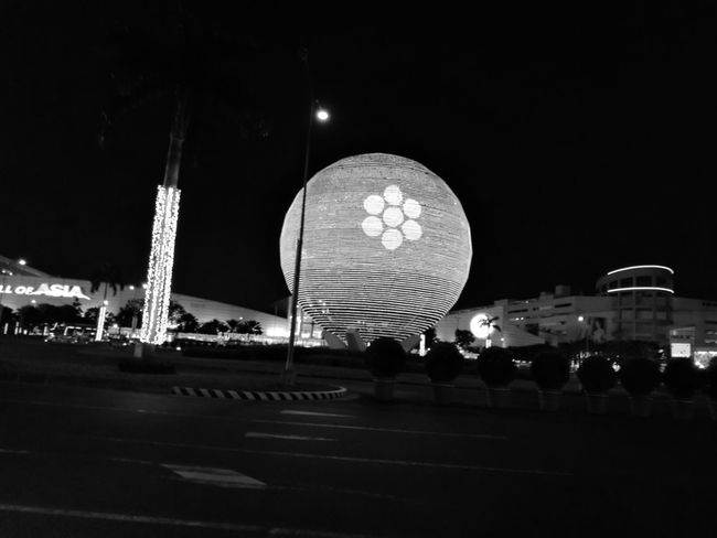 GlobePhoto Night Photography Monochrome Monochrome Photography Black & White Illuminated Road Sign Building Building Structures Architectural Feature Globe Architecture Light And Shadow LEDLights LED Light Light And Dark Light Show Road Lane Flower Head Flower Nightshot Circle Of Light Circle Frame Round Shape Round Building Trees