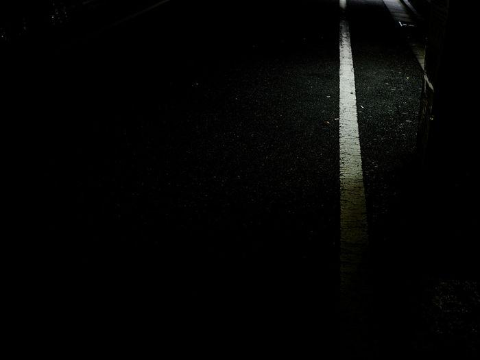 Full frame shot of empty road at night