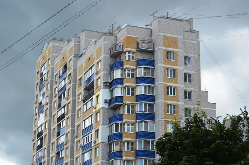 Low angle view of residential building against sky