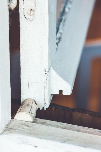 Close-up of cork on window