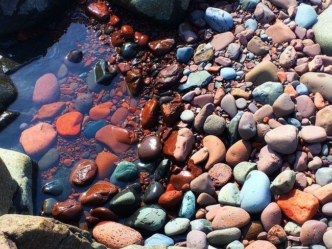 Contrasts between wet and dry rocks Beauty In Nature Colorful Contrasts Dry Rocks Nature No People Outdoors Pebble Pebble Beach Pebbles Rock - Object Rocks Stones Water Wet Rocks