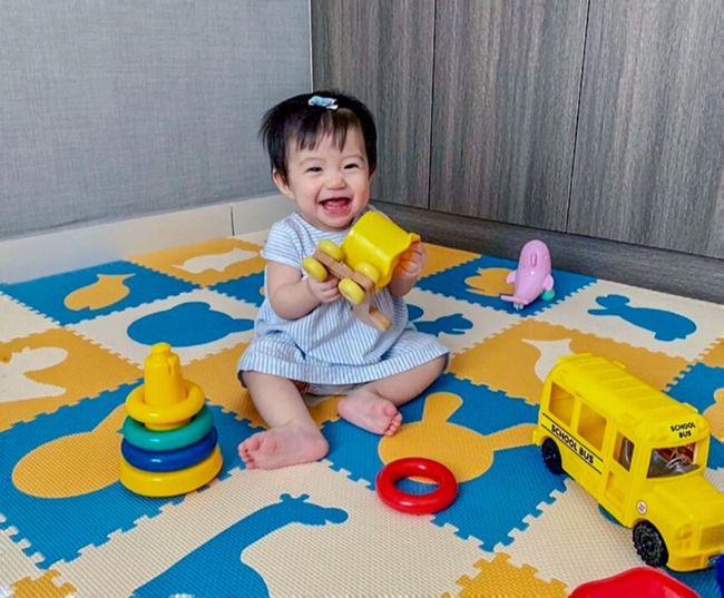 Smiling Childhood Child One Person Sitting Cute Toy My Best Photo Innocence Front View Looking At Camera Portrait Full Length Baby Multi Colored Indoors  Young Real People