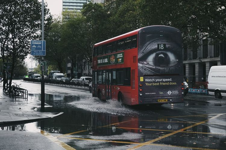Text on wet street in city
