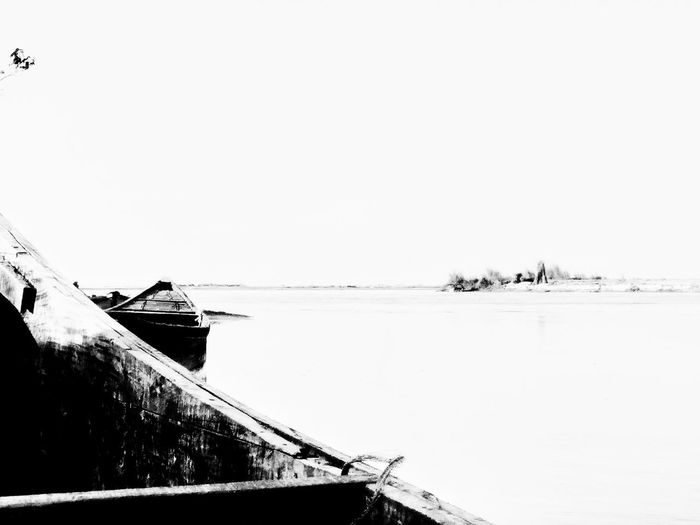 The Boats Mobilephotography Mobile Photography Blackandwhite River Riverside Haldibari Teesta River Teesta Outdoors Tranquility Tranquil Scene Lake Day No People Nature Water Clear Sky Scenics Beauty In Nature Nautical Vessel Sky