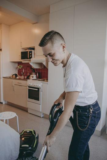 Young man looking at camera at home
