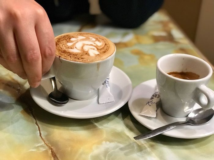Cappuccino and coffe art #spoon #espresso EyeEm Selects Coffee Cup Coffee - Drink Food And Drink Saucer Drink Refreshment Cup Frothy Drink Indoors  Cappuccino Table Human Hand Freshness One Person Close-up Froth Art Holding Cafe Human Body Part Food First Eyeem Photo