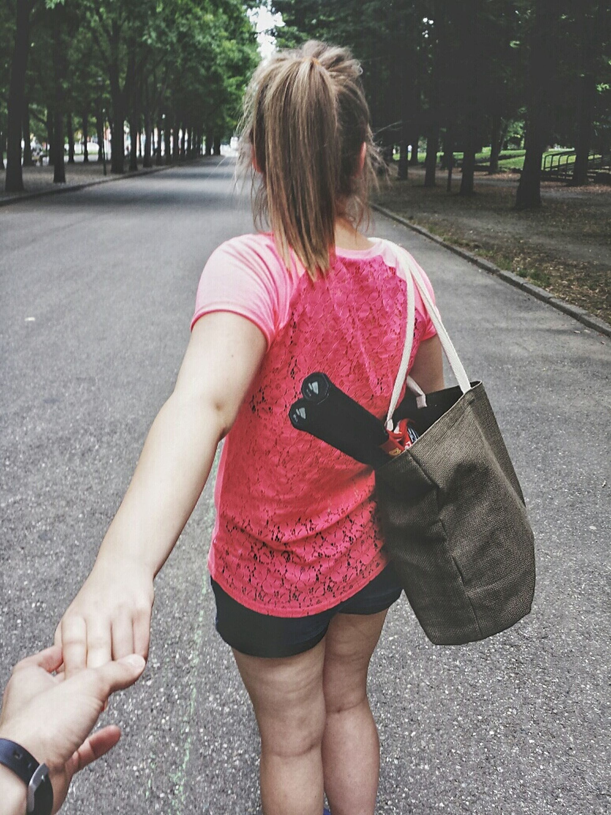 childhood, lifestyles, leisure activity, full length, casual clothing, girls, elementary age, person, innocence, togetherness, rear view, cute, love, holding, park - man made space, boys, street
