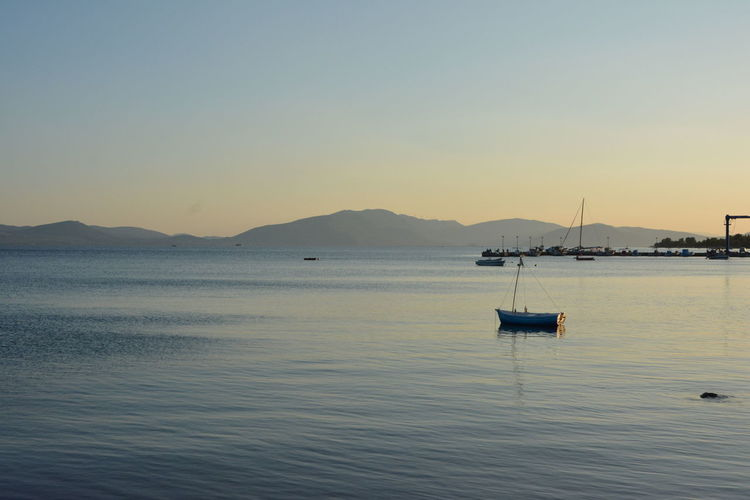 Fishing boats by the sea in Euboea, Greece Water Sky Nautical Vessel Transportation Tranquility Scenics - Nature Beauty In Nature Mode Of Transportation Sea Waterfront Tranquil Scene Mountain Copy Space Clear Sky Nature Sunset No People Non-urban Scene Idyllic Outdoors Sailboat Rowboat