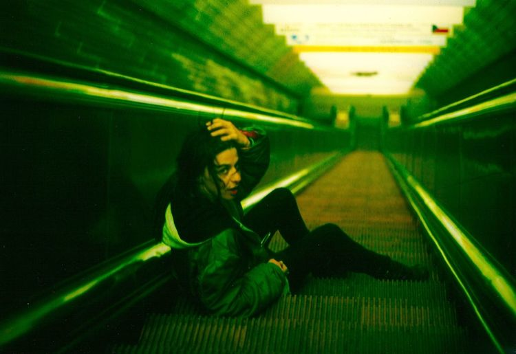 on the way down On The Way Down Prague Czech Republic Prague Subway Adult Adults Only Full Length Green Color Illuminated Indoors  Night One Person One Woman Only One Young Woman Only Only Women People Prague Subway Station Subway Subway Station Women Young Adult Young Women An Eye For Travel The Graphic City Stories From The City The Street Photographer - 2018 EyeEm Awards The Fashion Photographer - 2018 EyeEm Awards The Traveler - 2018 EyeEm Awards