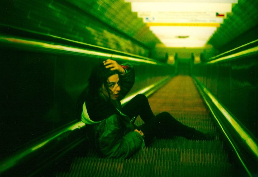 on the way down On The Way Down Prague Czech Republic Prague Subway Adult Adults Only Full Length Green Color Illuminated Indoors  Night One Person One Woman Only One Young Woman Only Only Women People Prague Subway Station Subway Subway Station Women Young Adult Young Women An Eye For Travel The Graphic City Stories From The City The Street Photographer - 2018 EyeEm Awards The Fashion Photographer - 2018 EyeEm Awards The Traveler - 2018 EyeEm Awards Urban Fashion Jungle HUAWEI Photo Award: After Dark #urbanana: The Urban Playground