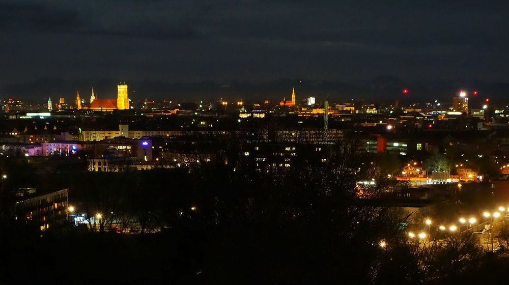 Muenchen Munich at Night with Alps in the back