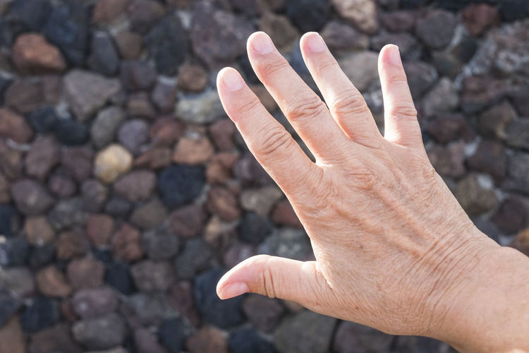Close-up of human hand outdoors