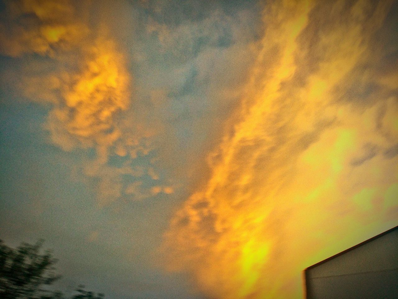 sky, cloud - sky, low angle view, no people, beauty in nature, sunset, nature, outdoors, built structure, scenics, building exterior, architecture, storm cloud, day