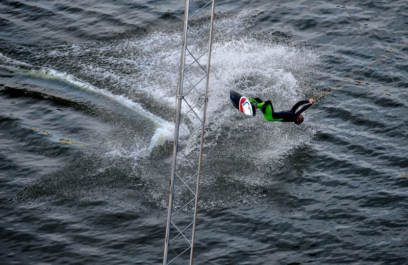 Man kiteboarding in sea