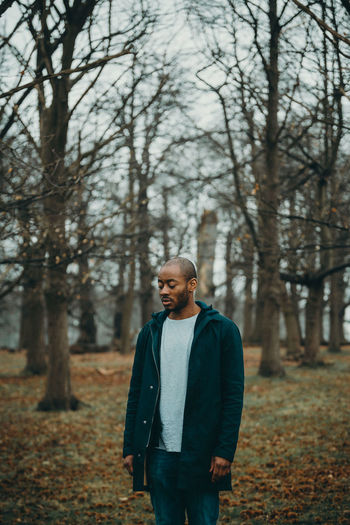 Title: Take 2 Eric Kole is an up and coming actor living in trying to build his career and make a name for himself in a tough this series, I tried to take two shots in each spot to portray the different emotions within vs vs vs exploration vs Inward focus vs of those emotions are either good or just beautiful Richmond Park in London in a cold winter's morning provided a lonely eery backdrop for the shoot. Actor Contemplation Emotions Lonely Richmond Park, London The Portraitist - 2018 EyeEm Awards Trees Hopes And Dreams Male Outdoors Portrait Photography Trees And Sky Wilderness