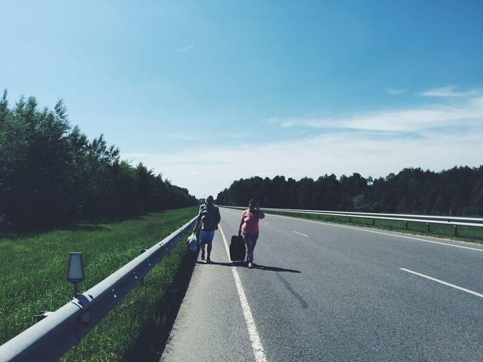A man and a woman walking through the buffer some between Belarus and Ukraine border with languages on a very hot day EyeEm Best Shots Beautiful Nature Belarus Ukraine