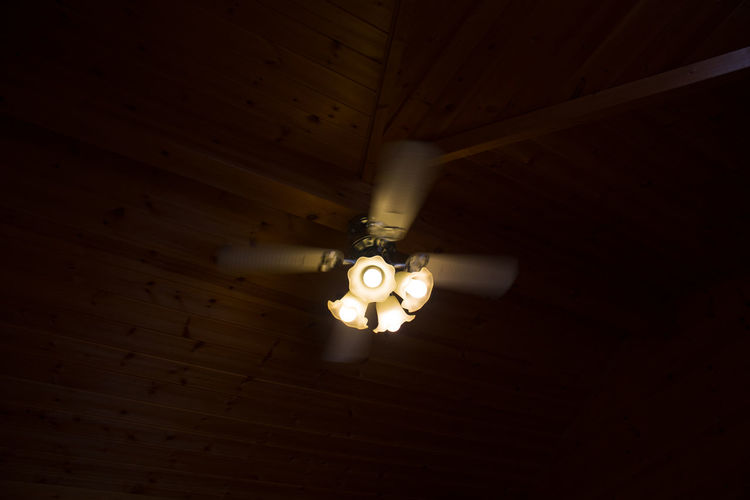 Low angle view of lighting equipment hanging from ceiling at home