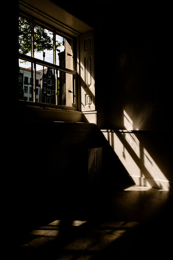 Amsterdam Huis Marseille Shadow And Light Sunshine And Shadows Sunshine ☀ The Week on EyeEm Absence Architecture Building Built Structure Dark darkness and light Day Domestic Room Furniture House Indoors  Nature No People Railing Shadow Sunlight Window Window View