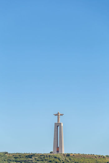 King Christ Statue Almada Open Arms Portugal Statue Architecture Belief Blue Built Structure Christ Clear Sky Copy Space Cross Day Field King Christ Land Nature No People Outdoors Religion Sky Spirituality Sunlight Tall - High Tower