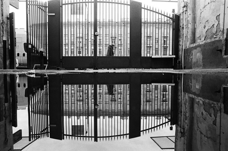 Analog; Ilford HP5 400 The Week on EyeEm Light And Shadow Capture The Moment Black And White Bnw Monochrome Film Analogue Photography Architecture Building Built Structure No People Building Exterior Day Security Safety Metal Punishment Protection Prison Window Prison Cell Outdoors Railing Nature Entrance Closed The Art Of Street Photography