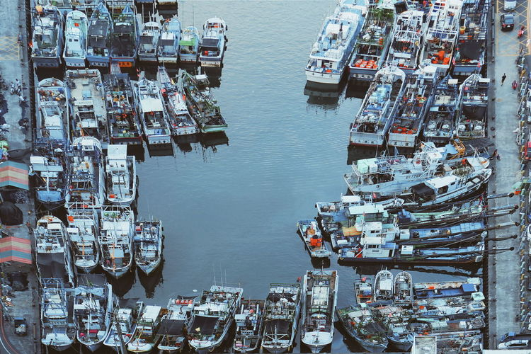 High Angle View Of Trawlers Moored At Harbor