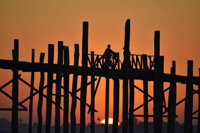 The Architect - 2017 EyeEm Awards Burma Orange Color Skyline At Sunset  Sunset Silhouette Bridgesaroundtheworld Mandalay EyeEmNewHere Ubeinbridge