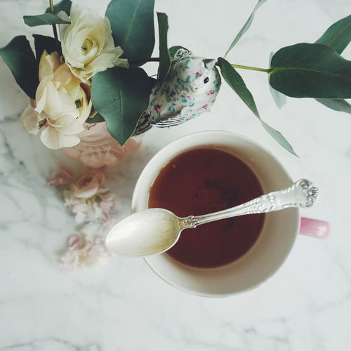 Tea and flowers Close-up Cup Cup Of Tea Day Dead Flowers Drink Flower Food And Drink Freshness Healthy Eating Indoors  Marble No People Overhead View Refreshment Silver  Silver Spoon Table Tea - Hot Drink Tea Cup Topdown