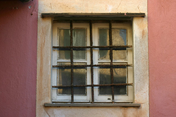 Afternoon Light Copy Space Pink Wall Architecture Building Exterior Close-up Day Daylight Glass Grate Iron Grate Italy Liguria Metal No People Old Village One Person Outdoors Symmetry Wall Square Window White Window Windows