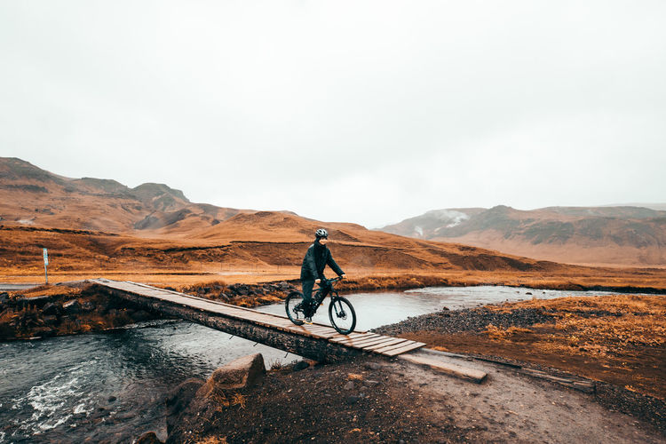 Mountain Bicycle Transportation One Person Sky Activity Sport Nature Mountain Range Full Length Lifestyles Men Beauty In Nature Leisure Activity Cycling Day Road Riding Scenics - Nature Outdoors