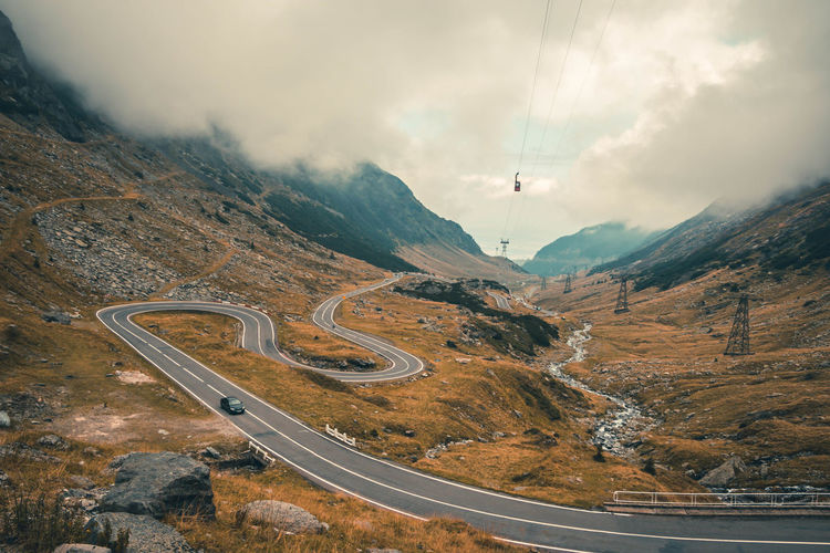 Beauty In Nature Day High Angle View Landscape Mountain Mountain Road Nature No People Outdoors Road Scenics Sky Tranquility Transportation Winding Road Go Higher