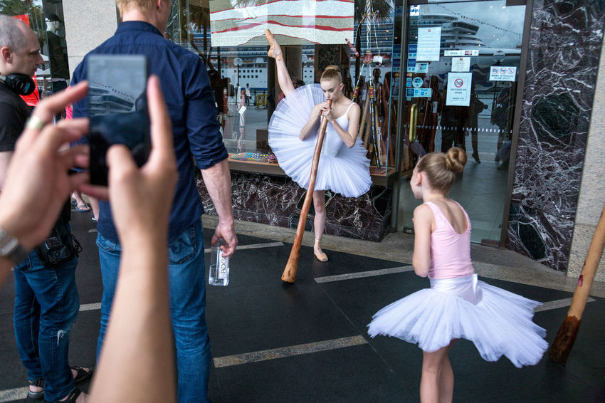 Street scene near Circular Quay in Sydney, Australia Australia Ballerina Aboriginal Art Ballet Ballet Dancer Child Childhood Circular Quay Crowd Cultural Appropriation Dancers Dancing Didge Didgeridoo Didjeridoo Girls Group Of People Mobile Phone Multitasking Pose Street Photography Streetphotography Sydney Women Young Adult The Street Photographer - 2018 EyeEm Awards The Photojournalist - 2018 EyeEm Awards