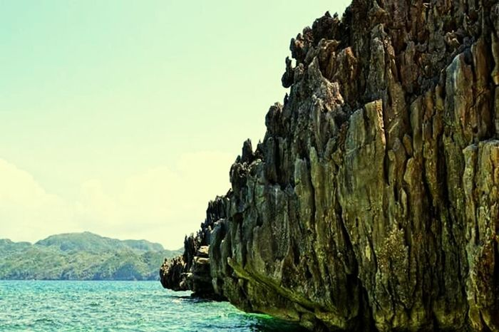 Rock Formation Caramoan Island, Camarines Sur Water Mountain Waterfront Solitude Nature Cliff Sky Sea Majestic Beauty In Nature Tranquility Caramoan Island, Philippines