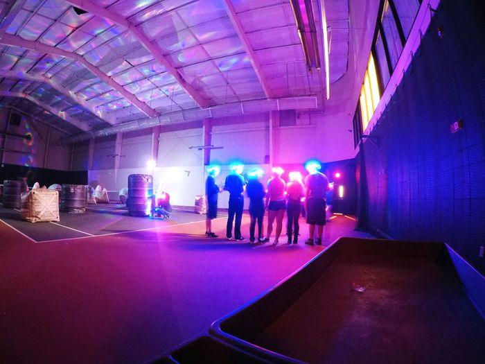 People in illuminated corridor