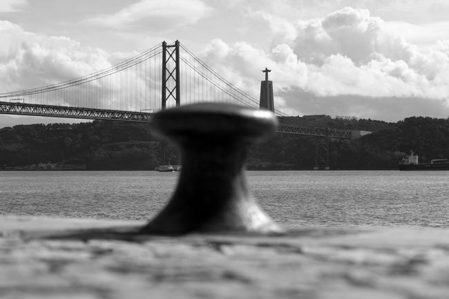 Focus On Background Dockside Bridge Tejo Black & White Black And White Blackandwhite Cityscape Riverside Blackandwhite Photography Bnw Eye4photography  EyeEm Cristo Rei (Portugal) EyeEm Best Shots EyeEm Bnw EyeEmBestPics Lisboa Monochrome Sky And Clouds Ponte 25 De Abril EyeEm Gallery Taking Photos at Lisbon Portugal