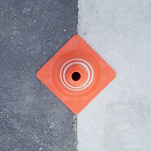 Close-up high angle view of traffic cone