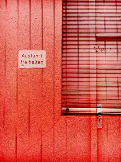 Double Exposure Photography Street Photography Streetphotography Red No People Pink Color Outdoors Text Day Close-up Architecture Street Building Exterior Built Structure Signs Sign Cityscapes Garage