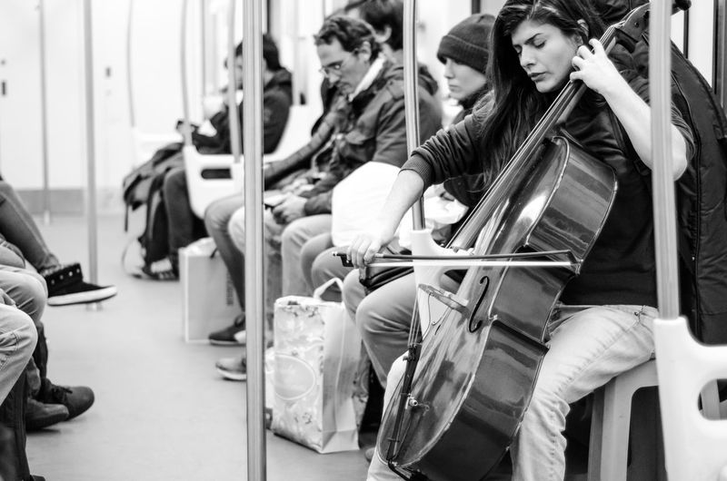 Playing cello in the subway Adult Cello Music Musician People Playing Cello Subway Subway People Subway Train Transportation Violonchelo Enjoy The New Normal