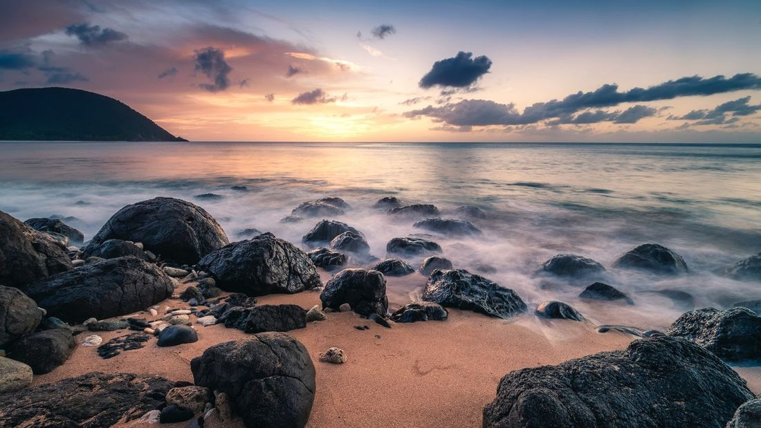 Sunset Grande Anse Beach, Guadeloupe Island. Guadeloupe Travel Sunset Explore EyeEmNewHere Sea Beach Sky Water Land Sunset Beauty In Nature Rock Horizon Over Water Cloud - Sky Nature Orange Color No People Rock - Object Horizon Scenics - Nature Tranquility Tranquil Scene Idyllic Solid