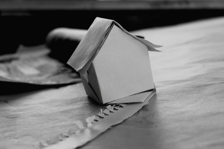 Close-Up Of Paper Model Home On Table