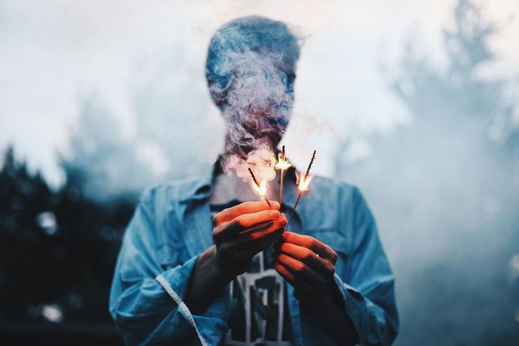 Full length of man holding cigarette