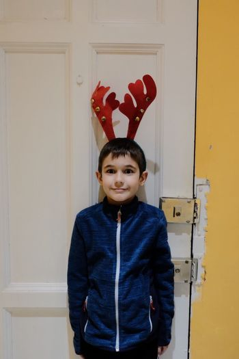 Oh. Just stop growing up, son... 🙈 // Door Waist Up Red Front View Real People One Person Childhood Looking At Camera Portrait Indoors  Standing Day People Christmas Time Happiness The Week On EyeEm Yellow Taking Photos Boy Costume Impatient Family Sooc Fujifilm_xseries Time Passes By