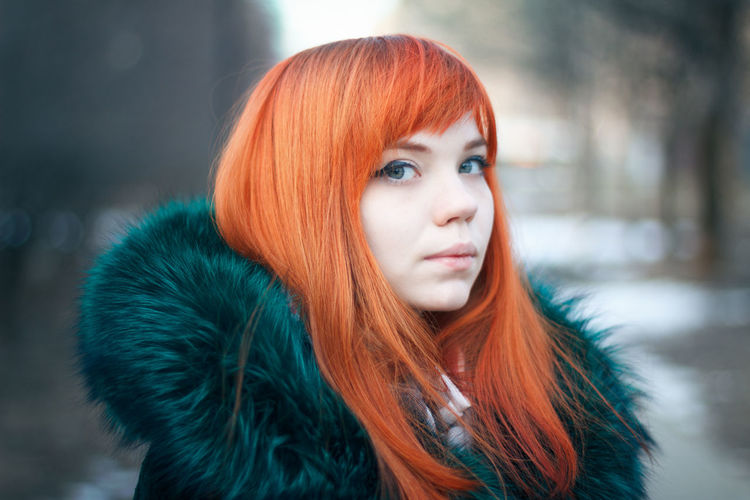 Close-up portrait of young woman in winter