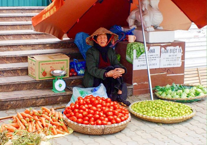 Gotta Be An Easier Way To Make A Living Amateur Photography Hanoifood Fruit Seller Selling Fruit Vegetables Vietnam Hanoi, Vietnam Making A Living Side Of The Road Old Lady Conical Hat Under My Umbrella Umbrella Shade Street Photography