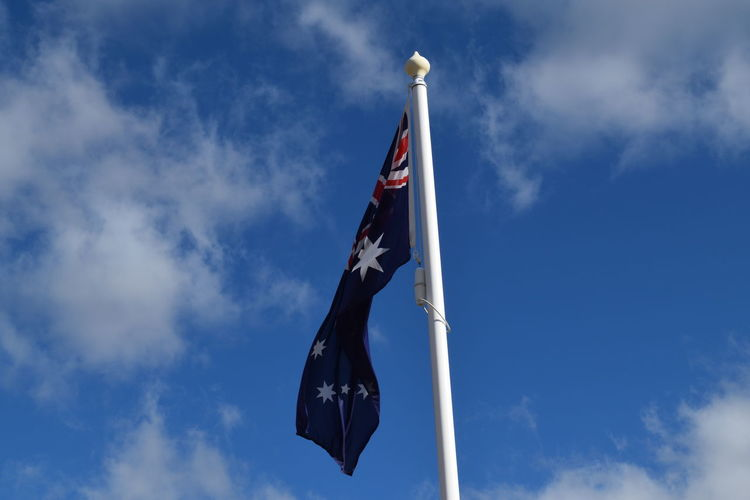 Low angle view of australian flag against sky