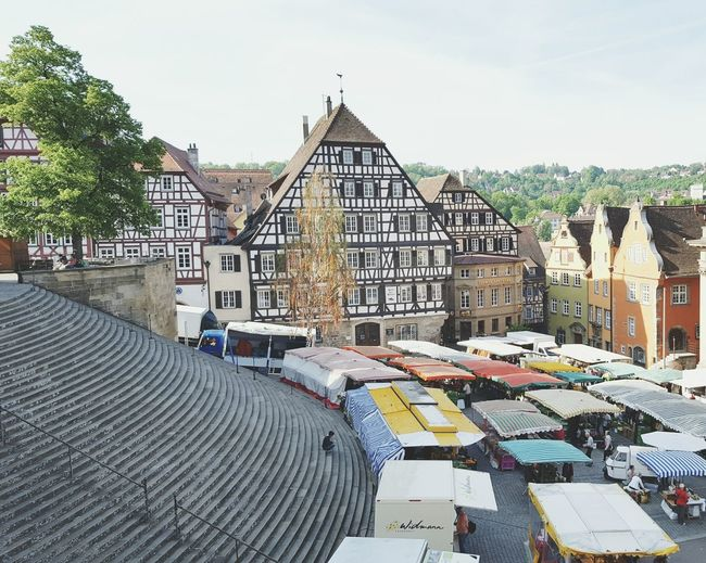 Peaceful saturday Schwäbisch Hall The Architect - 2016 EyeEm Awards Market Fresh Products Houses Facades Looking Down Peaceful Moment Stairs Person Sitting Timbered Houses Market Stalls Colorful City Village Life Saturdaymorning Shopping Time Vegetables Fruits People Walking  Architectural Detail Summer Views The Street Photographer - 2016 EyeEm Awards Stroller Round Stairs