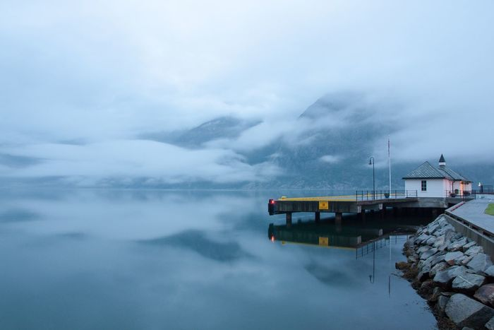 Midnight Nightphotography Cloudy Fjord Pier Water Reflections Low Clouds Atmospheric Mood Cloudy Sky Norway Copy Space Landscapes With WhiteWall Photography In Motion Eidfjord