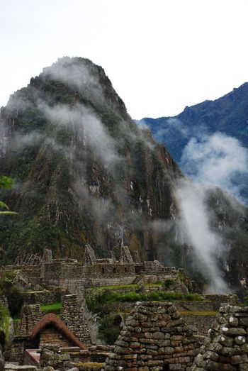 Scenic View Of Mountains At Machu Picchu In Foggy Weather